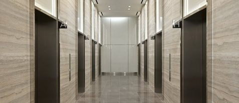 elevator lobby with multiple elevators along the walls